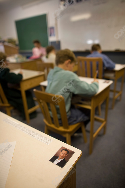 "Fundamentalist Mormon group F.L.D.S.,  Portraits of church leader Warren Jeffs on desks in a school room, ""Yearning for Zion"" compound in Eldorado, Texas, USA, February 11, 2009"
