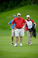 06/24/09 - Photo by John Cheng for Newsport.   USA Gymnastics President Steve Penny hits from the fairway at the Travelers Championship at the TPC River Highlands in Cromewll Connecticut.