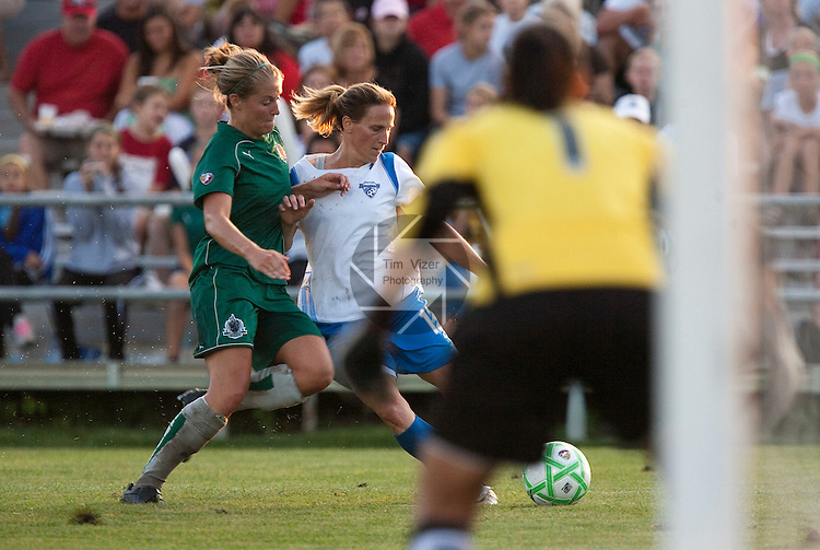 August 1 2009            Athletica's Elise Weber (12, left) and Breakers Captain Kristine Lilly (13, right) charge for the ball late in the first half.   At far right, back to camera, is Athletica goalkeeper Hope Solo.   The St. Louis Athletica of the Women's Professional Soccer league hosted the Boston Breakers on Saturday August 1, 2009 at the Anheuser Busch Soccer Park in Fenton, Missouri.   The Athletica won, 1-0, and clinched a spot in the post-season playoffs...            *******EDITORIAL USE ONLY*******
