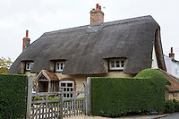 UK, England, Ewelme.  Thatched Roof on an English Cottage.