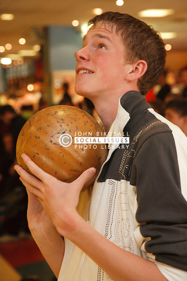 Teenager at bowling alley.