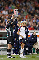Fourth official Byran Roslund signals a substitution involving United States midfielder Leslie Osborne (12). The women's national team of the United States defeated Canada 6-0 during an international friendly at Robert F. Kennedy Memorial Stadium in Washington, D. C., on May 10, 2008.
