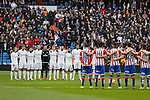 Real Madrid´s and Sporting de Gijon´s players keep a minute of silence during 2015/16 La Liga match between Real Madrid and Sporting de Gijon at Santiago Bernabeu stadium in Madrid, Spain. January 17, 2015. (ALTERPHOTOS/Victor Blanco)
