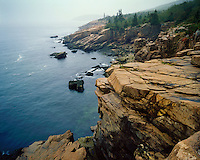 Foggy morning light along the cliffs near Sand Beach; Acadia  National Park, ME