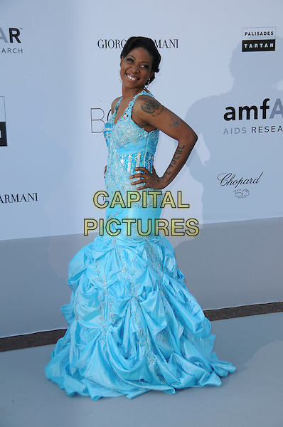 SUZANNE ENGO.arrivals at amfAR's Cinema Against AIDS 2010 benefit gala at the Hotel du Cap, Antibes, Cannes, France during the Cannes Film Festival.20th May 2010.amfAR full length long maxi blue dress hand on hip ruched sleeveless beaded .CAP/CAS.©Bob Cass/Capital Pictures.