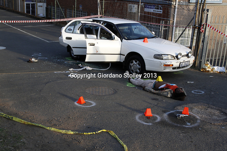 DURBAN - 19 August 2013 - A crime scene in the Westmead Industrial complex of Pinetown where a hijacker was shot and killed by his intended victim. The victims - a husband and wife - were wounded in the shoot out and rushed to hospital while the hijacker's three accomplices fled. Picture: Allied Picture Press/APP