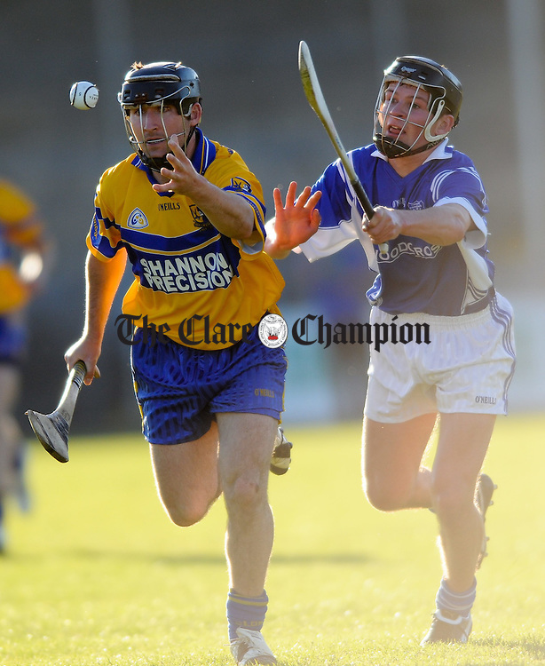 Caimin Morey of Sixmilebridge in action against Philip Gleeson of Cratloe during their senior championship game at Cusack park. Photograph by John Kelly.