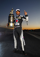 Nov 13, 2016; Pomona, CA, USA; NHRA top fuel driver Antron Brown poses for a portrait with the world championship trophy following the Auto Club Finals at Auto Club Raceway at Pomona. Mandatory Credit: Mark J. Rebilas-USA TODAY Sports