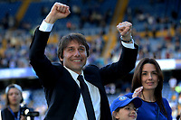 Chelsea Manager, Antonio Conte, walks around the pitch with his wife, Elisabetta Muscarello and daughter, Vittoria at the end of the match and celebrates with the fans during Chelsea vs Sunderland AFC, Premier League Football at Stamford Bridge on 21st May 2017