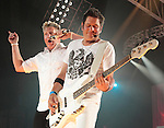 Gary LeVox and Jay DeMarcus of the country music band Rascal Flatts perform at the Susquehanna Bank Center in Camden New Jersey July 9, 2011.Copyright EML/Rockinexposures.com..