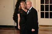 "Jeffrey ""Jeff"" Zucker, president of Cable News Network Inc., right, and Caryn Zucker arrive to a state dinner hosted by U.S. President Barack Obama and U.S. First Lady Michelle Obama in honor of French President Francois Hollande at the White House in Washington, D.C., U.S., on Tuesday, Feb. 11, 2014. Obama and Hollande said the U.S. and France are embarking on a new, elevated level of cooperation as they confront global security threats in Syria and Iran, deal with climate change and expand economic cooperation. <br /> Credit: Andrew Harrer / Pool via CNP"