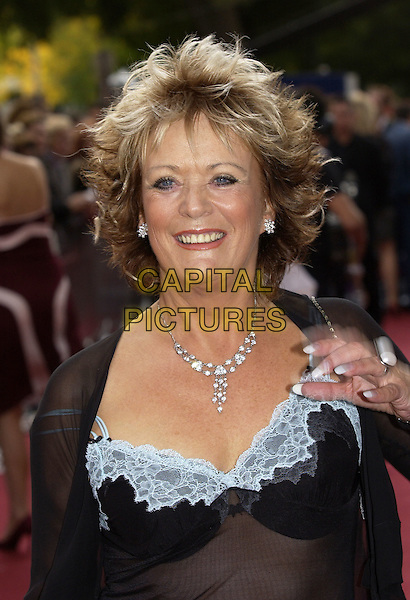 "SHERRIE HEWSON.ITV's ""The Celebrity Awards"".London 26 Setember 2004..half length loose women sheer black see through see thru dress white lace.www.capitalpictures.com.sales@capitalpictures.com.©Capital Pictures"