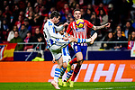 Saul Niguez of Atletico de Madrid (R) fights for the ball with Aritz Elustondo of Real Sociedad (L) during the La Liga 2018-19 match between Atletico de Madrid and Real Sociedad at Wanda Metropolitano on October 27 2018 in Madrid, Spain.  Photo by Diego Souto / Power Sport Images