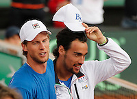 Italy's Fabio Fognini  and Andreas Seppi celebrate  after winning    Davis Cup quarter-final tennis match against Britainy and qualify for semifinal  in Naples April 6, 2014.