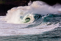 A big hollow wave breaks at Waimea Shorebreak in Waimea Bay, North Shore, O'ahu.