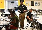 St. Louis County Police Lt. James Morgan (standing) gives instructions for an assessment test to attendees at a Diversity Fair sponsored by the St. Louis County branch of the Ethical Society of Police. Morgan is also president of this branch of the ESOP. The fair was held at Hazelwood Central High School on Saturday August 11, 2018 with police agencies from ten different jurisdictions represented.   Photo by Tim Vizer