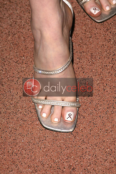 Alison Arngrim's toe painted with the AIDS ribbon
