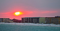 Beachwalkers soak up the sunset on Fort Walton Beach...COLIN HACKLEY PHOTO