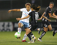 Homare Sawa #10 of the Washington Freedom tackles Casey Nogueira #27 of the Chicago Red Stars during a WPS match at the Maryland Soccerplex, in Boyds Maryland on June 12 2010. The game ended in a 2-2 tie.