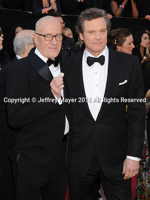 HOLLYWOOD, CA - FEBRUARY 27: Geoffrey Rush, Colin Firth arrive at the 83rd Annual Academy Awards held at the Kodak Theatre on February 27, 2011 in Hollywood, California.