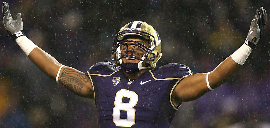 Oct 09, 20010:  Washington safety #8 Nate Williams raises his hands in the air to pump up the fans against Arizona State.  Arizona State defeated Washington 24-14 at Husky Stadium in Seattle, Washington.