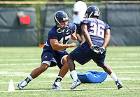 Virginia linebacker Bill Schautz(547) and Virginia running back Max Milien during open spring practice for the Virginia Cavaliers football team August 7, 2009 at the University of Virginia in Charlottesville, VA. Photo/Andrew Shurtleff