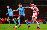 Matt Ritche of Newcastle in action with Peter Crouch of Stoke during the EPL - Premier League match between Stoke City and Newcastle United at the Britannia Stadium, Stoke-on-Trent, England on 1 January 2018. Photo by Bradley Collyer / PRiME Media Images.