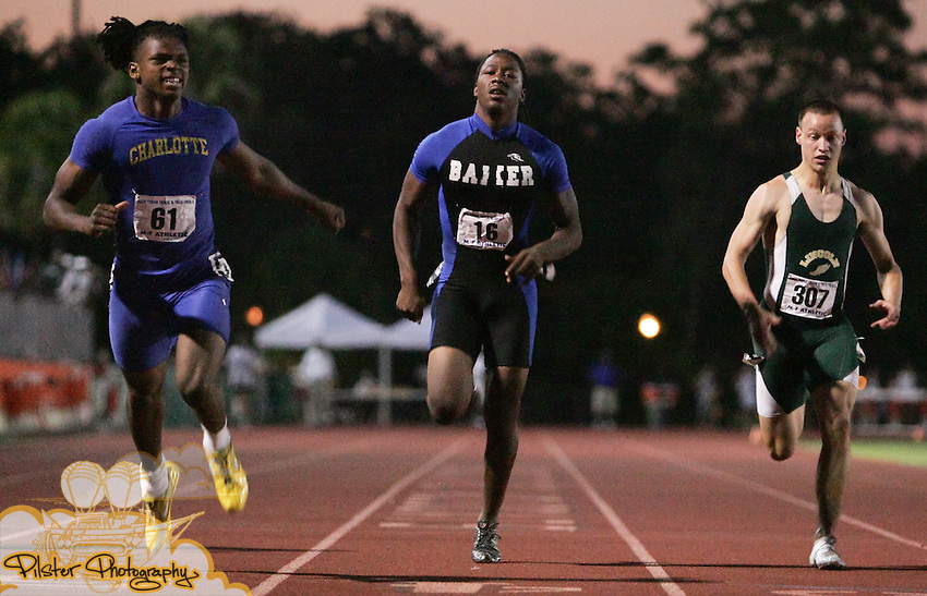 Joseph Byrd (16), from Baker , places 3rd in the 200m dash on Friday, May 8, 2009, during the FHSAA Class 3A Track and Field Finals at Showalter Field in Winter Park.  (Chad Pilster, PilsterPhotography.com for the Fort Myers News-Press)