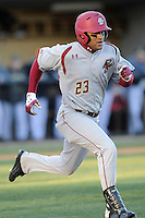 Center fielder Gabriel Hernandez (23) of the Boston College Eagles runs toward first in a game against the Wofford College Terriers on Friday, February 13, 2015, at Russell C. King Field in Spartanburg, South Carolina. Wofford won, 8-4. (Tom Priddy/Four Seam Images)