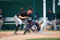Pittsburgh Pirates pitcher Mike Wallace (30) attempts to tag Nelson Gomez (40) sliding home during a minor league Spring Training game against the New York Yankees on March 26, 2016 at Pirate City in Bradenton, Florida.  (Mike Janes/Four Seam Images)