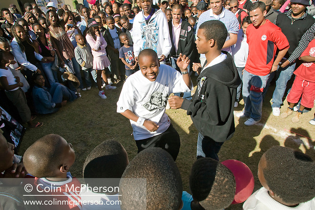 Young people dancing to African hip-hop music in Mbabane, Swaziland. The Kingdom of Swaziland (population 1.1m), a small, landlocked country in southern Africa was bordered by South Africa on three sides and Mozambique to the east, with Mbabane as its administrative capital. At the start of the 21st century, the country had the highest incidence per head of population of HIV/Aids in the world and and high levels of poverty mainly in rural areas where 75 per cent of the population lived.