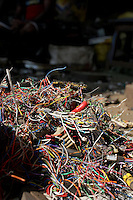Piles of wiring in a used electronics market in central Kolkata.<br />