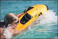BNPS.co.uk (01202 558833)<br /> Pic: Seabob/BNPS<br /> <br /> ***Please Use Full Byline***<br /> <br /> Swim with the fishes...<br /> <br /> Das Boot - German engineers have launched a James Bond-style 'underwater jetski' which enables watergoers to &quot;swim like a dolphin&quot;.<br /> <br /> The cutting-edge watercraft uses a revolutionary electric jet which generates 700 newtons of thrust, propelling users along under the waves at speeds of up to nine miles per hour with a range of 60 minute before recharging.<br /> <br /> The jet system is the first in the world to feature an impeller powered by an electric motor, which sucks in water then fires it out the back of the craft.<br /> <br /> It can dive to more than 100ft, and the craft's speed is controlled by hand controls to flick through its 10 gears.<br /> <br /> The craft is steered by using bodyweight to angle the craft, while an onboard computer informs users of power usage, depth, water temperature and speed.<br /> <br /> The range start at &pound;7000 but buyers can splash out almost &pound;30,000 for a top of the range one that comes with all the added extras.<br /> <br /> The futuristic machine, called the Seabob F7 Titanium, is the brainchild of Cayogo based in Stuttgart, Germany.