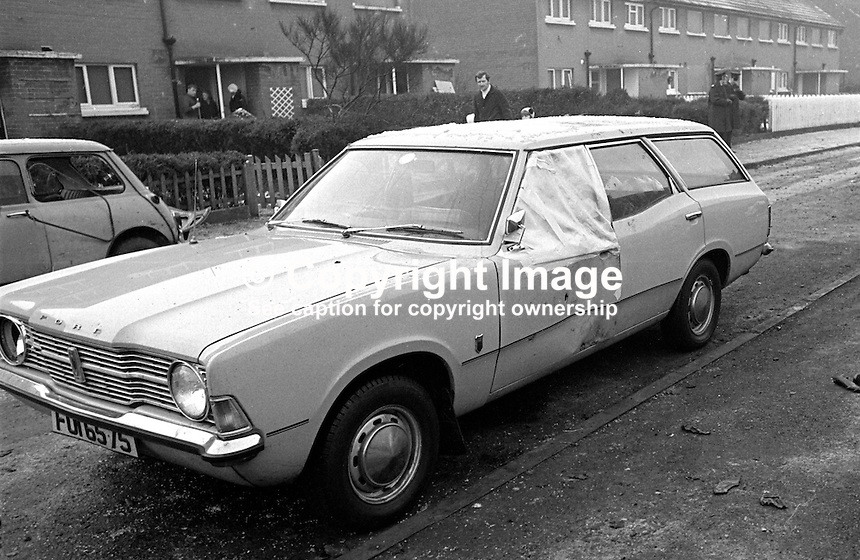 The family car in which 15 months old Graeme Dougan was sitting on his mother's knee on 1st January 1977 when a 100 car bomb exploded as police were still clearing the area at Harmin Park, Glengormley, Newtownabbey, N Irleland. Graeme was struck by shrapnel and died at the scene. A sheet of plastic covers the passenger side window which took the full force of the blast. Two men were convicted in connection with the incident the following year. They were each sentenced to 18 years,  197701010026b..Copyright Image from Victor Patterson, 54 Dorchester Park, Belfast, UK, BT9 6RJ..Tel: +44 28 9066 1296.Mob: +44 7802 353836.Voicemail +44 20 8816 7153.Skype: victorpattersonbelfast.Email: victorpatterson@me.com.Email: victorpatterson@ireland.com (back-up)..IMPORTANT: If you wish to use this image or any other of my images please go to www.victorpatterson.com and click on the Terms & Conditions. Then contact me by email or phone with the reference number(s) of the image(s) concerned.