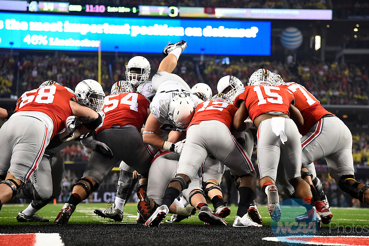 12 JAN 2015:  Cardale Jones (12) of the Ohio State University rushes against the University of Oregon during the College Football Playoff National Championship held at AT&T Stadium in Arlington, TX.  Ohio State defeated Oregon 42-20 for the national title.  Jamie Schwaberow/NCAA Photos
