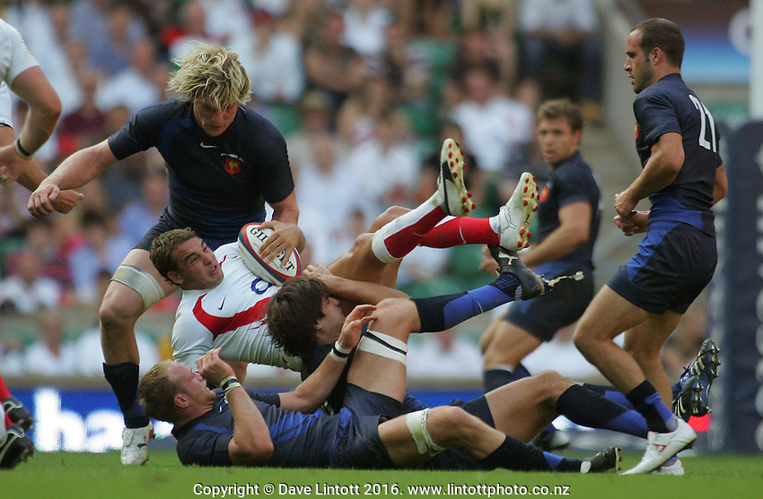England's Olly Barkley tumbles over French defenders as England desperately try to salvage victory with time running out. England v France. International Rugby Union. Twickenham, London, England. Saturday 11 August 2007. Photo: Dave Lintott / lintottphoto.co.nz