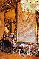 "Naked brick walls at The Baccarat Restaurant ""Le Cristal Room"", in the old dining room. Crystal chandeliers and glasses. Designed by Philippe Starck. The Cristal Room restaurant: both gilded mirrors and naked brick walls"