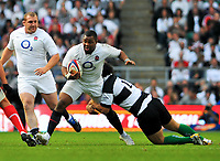 Steffon Armitage gets tackled in possession, with Tim Payne in support. MasterCard Trophy International match between England and the Barbarians on May 30, 2010 at Twickenham Stadium in London, England. [Mandatory Credit: Patrick Khachfe/Onside Images]