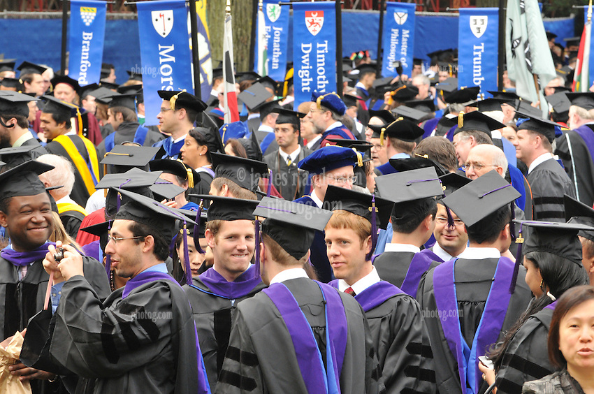 Yale University Commencement 2009 | Students Congregating on Cross Campus before the Ceremony. Caps, Gowns & Residential banners in background.