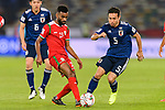 Harib Al Saadi of Oman (L) fights for the ball with Nagatomo Yuto of Japan (R) during the AFC Asian Cup UAE 2019 Group F match between Oman (OMA) and Japan (JPN) at Zayed Sports City Stadium on 13 January 2019 in Abu Dhabi, United Arab Emirates. Photo by Marcio Rodrigo Machado / Power Sport Images