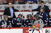 Jeff Wight (UConn - 21), Mike Cavanaugh (UConn - Head Coach), Jesse Schwartz (UConn - 17), Joey Ferriss (UConn - 28), Shawn Pauly (UConn - 9), Joe Pereira (UConn - Assistant Coach) - The Boston University Terriers defeated the visiting University of Connecticut Huskies 4-2 (EN) on Saturday, October 24, 2015, at Agganis Arena in Boston, Massachusetts.