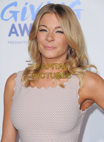 LeAnn Rimes.attends The  American Giving Awards held at Dorothy Chandler Pavilion in Los Angeles, California, USA, .December 9th 2011..portrait headshot beige nude sleeveless grey gray wavy edge trim earrings make-up beauty .CAP/RKE/DVS.©DVS/RockinExposures/Capital Pictures.