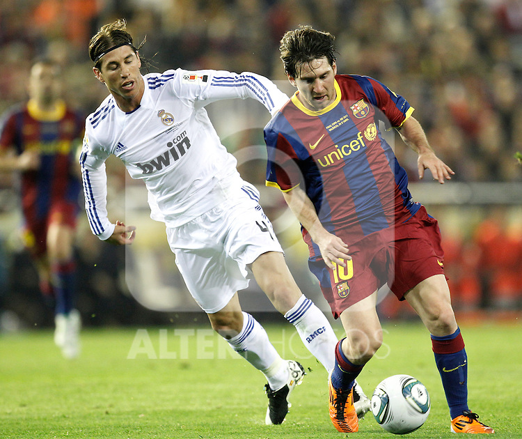 Real Madrid's Sergio Ramos vs Barcelona's Lionel Messi during Spain's King's Cup Final match in Valencia, Spain on April 20th 2011...Photo: Cesar Cebolla / ALFAQUI
