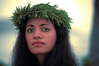 Head shot of a Hawaiian woman wearing  a fern haku lei.