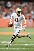 Boston College Eagles quarterback Chase Rettig (11) scrambles looking to pass during a game against the Syracuse Orange at the Carrier Dome on November 30, 2013 in Syracuse, New York.  Syracuse defeated Boston College 34-31.  (Copyright Mike Janes Photography)