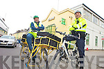 Postman Michael O'Callaghan and Community Guard Dave Rath are gearing up for the first Gardai versus Postmen race this Saturday as part of the Kerry Bicycle Festival.
