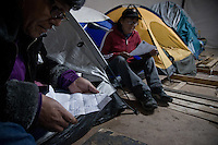 Chile, Copiapo, ago 2010.Relatives of the 33 miners are waiting for the rescue. Guadalupe Alfaro is reeding the letter of his son Carlos Bugeño Relatives, friends and rescue team around the mine where 33 miners are trapped in a collapsed tunnel 700 meters under the ground in North of Chile