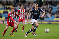 Millwall's Steve Morison in action as Brentford's Ryan Woods looks on during Millwall vs Brentford, Sky Bet EFL Championship Football at The Den on 10th March 2018