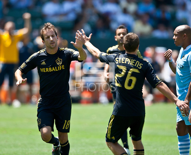 CARSON, CA – July 24, 2011: LA Galaxy Mike Magee (18) celebrates his goal during the match between LA Galaxy and Manchester City FC at the Home Depot Center in Carson, California. Final score Manchester City FC 1 and LA Galaxy 1. Manchester City wins shoot out 7, LA Galaxy 6.