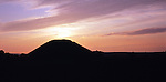 Silhouette of Silbury Hill at sunset, Wiltshire, England